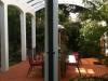 curved white timber verandah