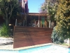 pool slatted timber wall screen