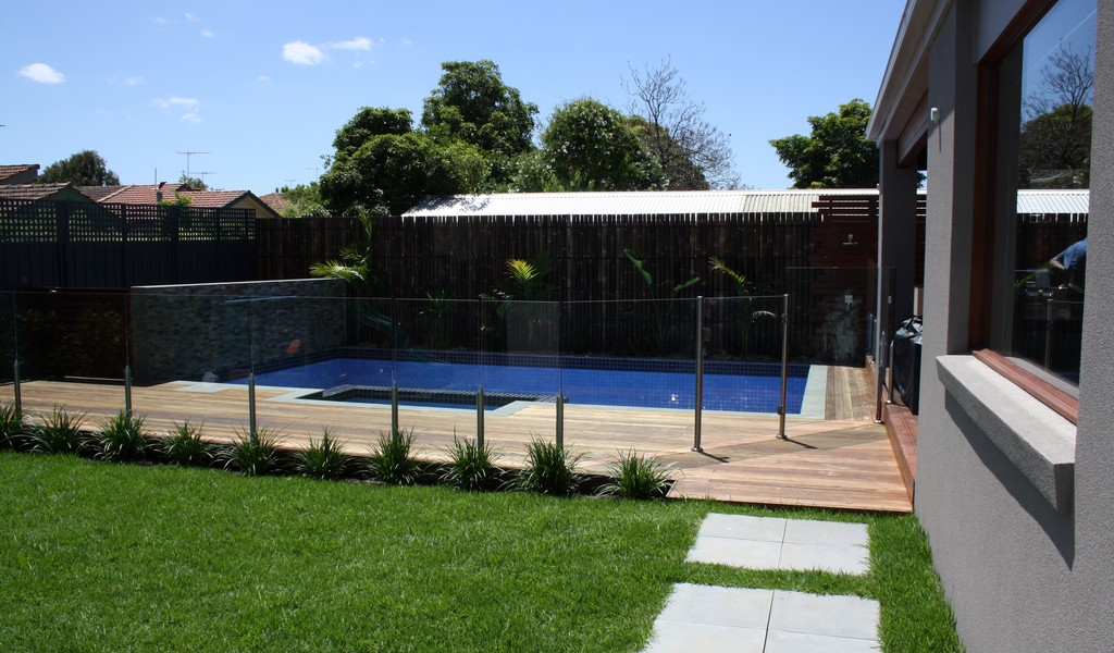 landscaping glass pool fence